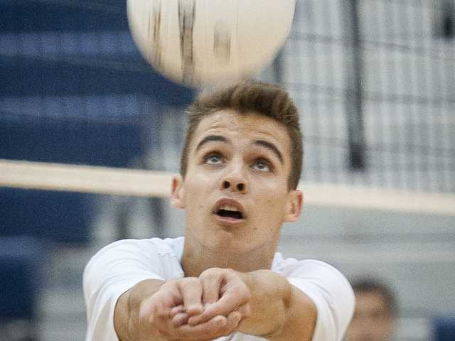 West Ranch's Ethan Marshall digs the ball during Wednesday's game against Valencia at West Ranch High.