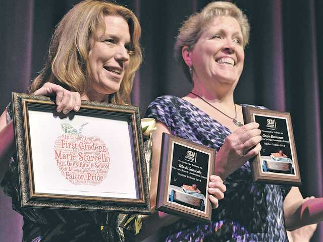 Sulphur Springs School District teacher honorees Marie Scarcello, left, and Angie Buchanan display their certificates and plaques to the audience at the 30th Teacher Tribute held at the Santa Clarita Performing Art Center at College of the Canyons in Valencia on Wednesday. Signal photo by Dan Watson.