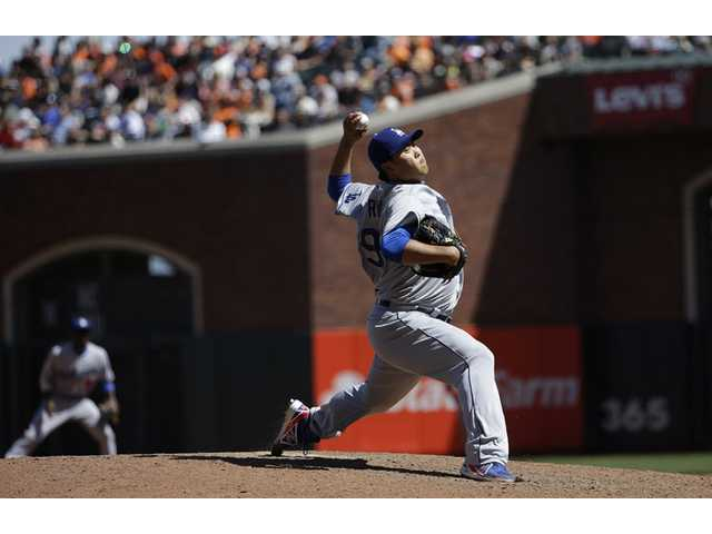 Dodgers pitcher Hyun-Jin Ryu (99) throws against the San Francisco Giants during the sixth inning of Thursday's game in San Francisco.