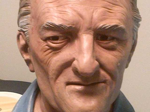 An age-progressed bust of the suspect which the FBI says is its Most Wanted list suspected of bludgeoning his mother, wife and three sons to death nearly 40 years ago.
