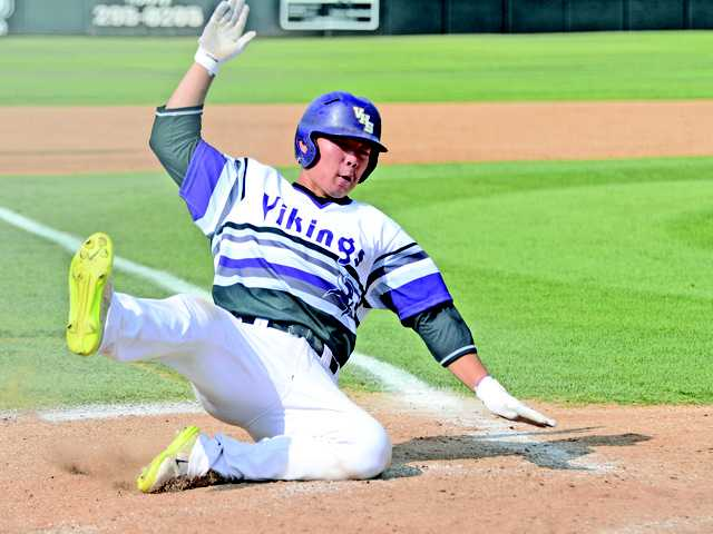 Valencia shortstop Keston Hiura slides into home during the third inning against West Ranch on Friday at Valencia High School. It was one of three runs scored by Hiura as Valencia won the game 4-2.