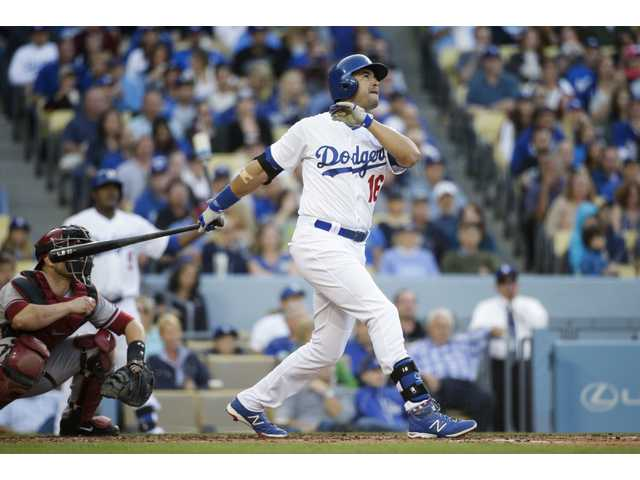 Los Angeles' Andre Ethier, right, watches the flight of his three-run home run during the fourth inning Saturday's game against the Diamondbacks in Los Angeles.