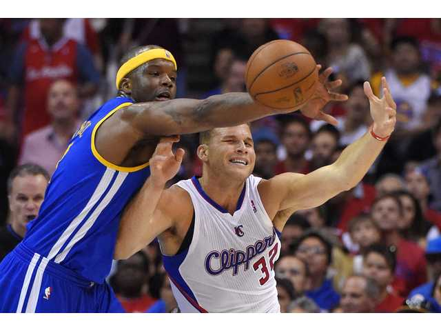Warriors center Jermaine O'Neal, left, blocks a pass meant for Los Angeles forward Blake Griffin during Saturday's Game 1 in Los Angeles.