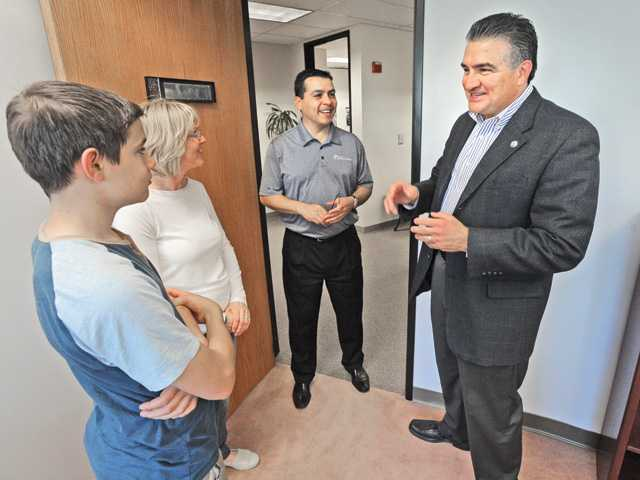 Santa Clarita Assistant City Manager Frank Oviedo, center, welcomes City Counilman-elect Danta Acosta, right, and his son D.J. and wife Carolyn at Santa Clarita City Hall on Friday. Signal photo by Dan Watson