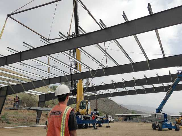Workers raise the roof on a covered riding arena at Carousel Ranch in Agua Dulce on Tuesday morning. Th equestrian therapy center has been raising money for the improvements since 2005. Signal photo by Austin Dave.
