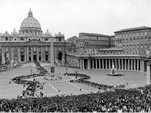This June 5, 1963 file photo shows a general overhead view of St. Peter's Square as a huge crowd moves on continuously into St. Peter's (background) where Pope John XXIII, who died June 3, lies in state.