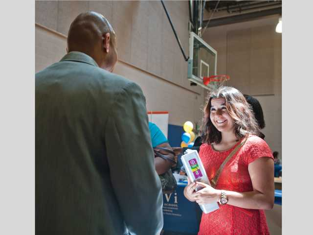 COC student Kendall Williams talks to André Pile, human resources recruiter for Henry Mayo Newhall Memorial Hospital, on Wednesday during a job fair at College of the Canyons. Signal photo by Charlie Kaijo.