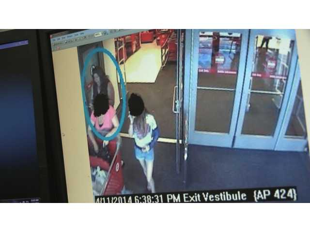 Sheriff's deputies believe the woman in this photo is a suspect in the wallet theft.