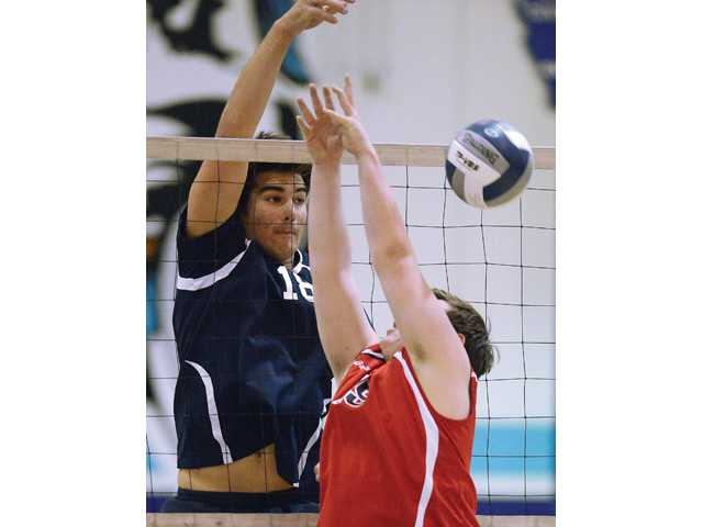 Saugus' Max Nua taps the ball down over Hart's Griffin Rost during the match at Saugus High School. Saugus won the match.