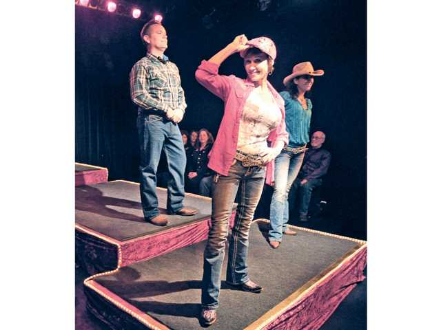 Three of the 12 celebrity models on stage, from left, Ovington Michael Owston, Shannon Bothe, and Jenny Ketchepaw, present western designer fashions and vintage cowboy apparel at the Cowboy Couture Fashion Show Thursday night in Newhall. Signal photo by Dan Watson.