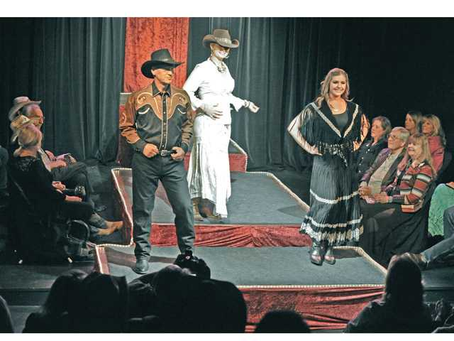 Celebrity models from left, Frank Rock, April Price, and Melissa Perlstein,  present western designer fashions and vintage cowboy apparel on stage at the Cowboy Couture Fashion Show on Thursday. Signal photo by Dan Watson.