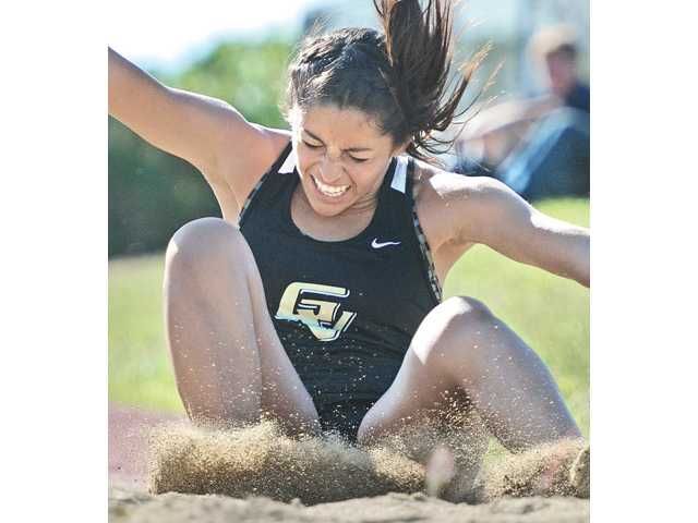 Golden Valley's Crystal Orellana lands the triple jump on Saturday at Golden Valley High School. Golden Valley defeated Saugus on the girls' side and the Centurion boys defeated the Grizzlies.