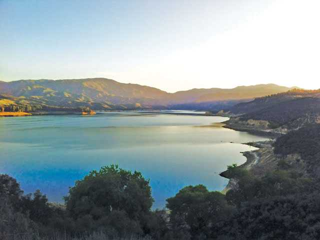 "Dawn on the road leading down to the upper lake main launch ramp from Lake Hughe's Road. The view is looking north up the ""fish arm"" of Castaic Lake. John Ragsdale"
