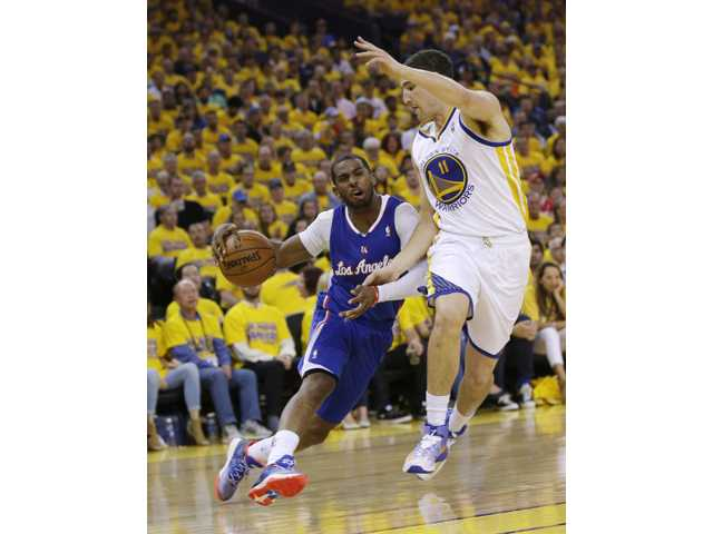 Los Angeles Clippers guard Chris Paul drives to the basket as Golden State Warriors guard Klay Thompson (11) defends on Thursday in Oakland.