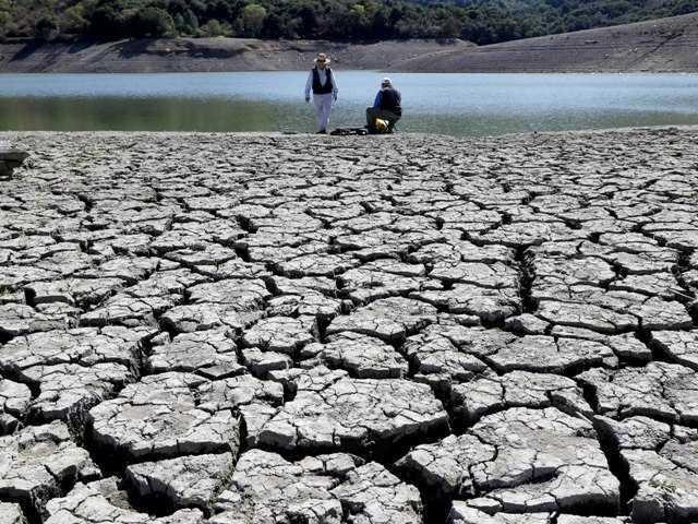 Gov. Jerry Brown has issued a second executive order to deal with California's drought. Above, cracks in the dry bed of the Stevens Creek Reservoir in Cupertino on March 13.