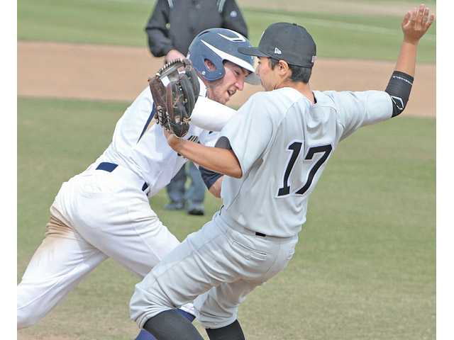 West Ranch's Jagger Rusconi, left, pushes Golden Valley's James Mendoza as Rusconi heads for home at West Ranch High on Friday.