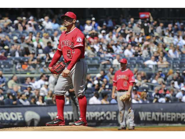 Los Angeles Angels starting pitcher Hector Santiago reacts after a balk call gave up a run against the New York Yankees on Saturday in New York.