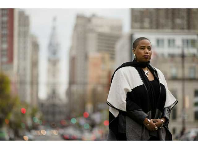 """Filmmaker and writer Aishah Shahidah Simmons, who teaches in the women's and LGBT studies program at Temple University, poses for a photograph Friday in Philadelphia. Students on college campuses across the country are increasingly asking their professors to provide """"trigger warnings"""" for classes that cover content that might be upsetting to individuals who have been sexually assaulted."""
