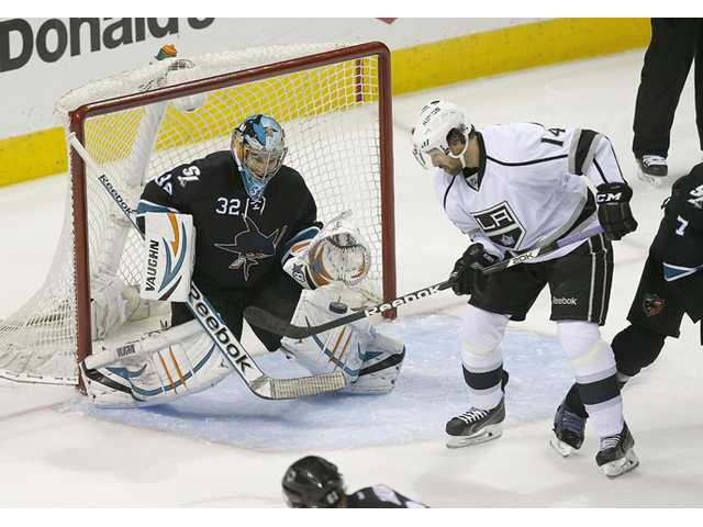 San Jose Sharks goalie Alex Stalock (32) blocks a goal attempt by Los Angeles Kings right wing Justin Williams (14) during Game 5 of a first-round playoff series in San Jose on Saturday.