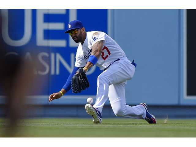 Los Angeles Dodgers center fielder Matt Kemp can't handle a ball against the Colorado Rockies on Sunday in Los Angeles.