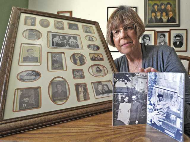 Holocaust survivor Erika Schwartz displays framed photos of relatives on her mother's side that were lost during the Holocaust, left, and her parents, Jolan Petrover and Herman Hornstein, in their engagement photo in 1941 and a photo, far right, of her father, who died in the Holocaust. Signal photo by Dan Watson.