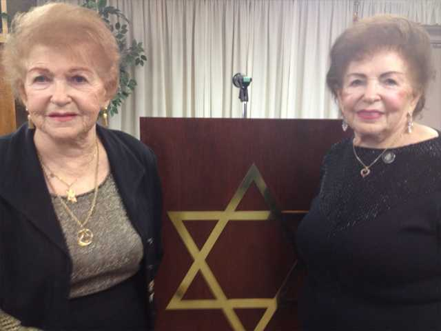 Twin sisters Rita Kahane, left, and Serena Rubin pose for a photo Sunday after speaking at Congregation Beth Shalom in Santa Clarita as part of Yom Hashoah (Holocaust Remembrance Day). The Hungarian-born sisters avoided being selected by Nazi doctor Josef Mengele, who experimented on Jewish twins during WWII. Signal photo by Jim Holt.