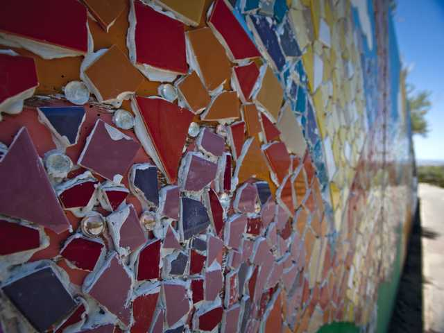 A close-up of shards of tile plastered on a mosaic on the Creekside Road bike trail in Santa Clarita. Volunteer are invited to join in round two of the project next weekend. Signal photo by Charlie Kaijo