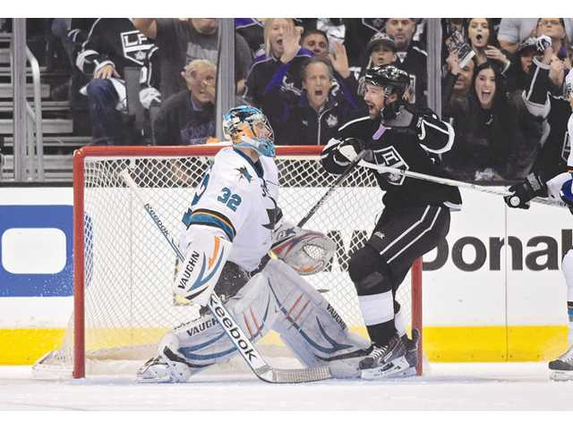 Los Angeles Kings right wing Justin Williams, right, celebrates his goal as San Jose Sharks goalie Alex Stalock looks on Monday in Los Angeles.