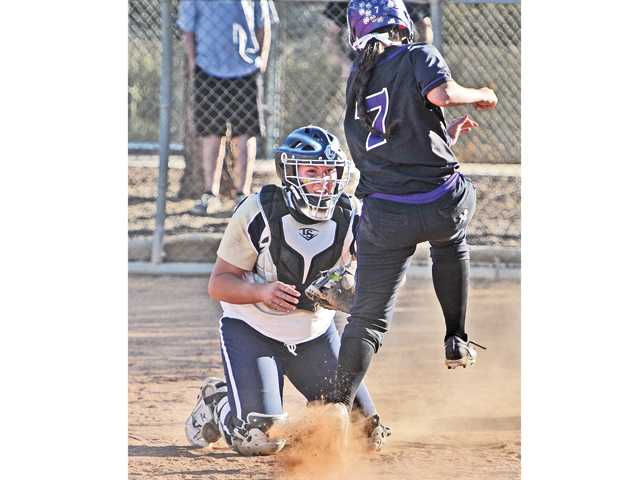 West Ranch catcher Keeley Walsh (3) makes the tag on Lauren Dolan (7) for the final out of the game against Valencia at West Ranch High on Tuesday.