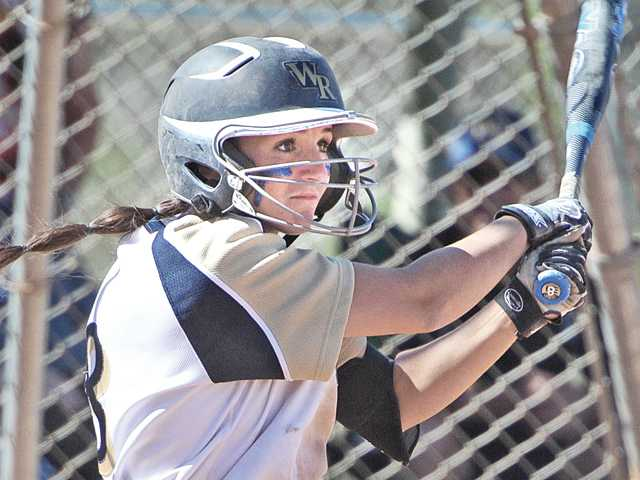 West Ranch's Lauren Lindvall (8) hits an RBI double against Valencia at West Ranch High on Tuesday.