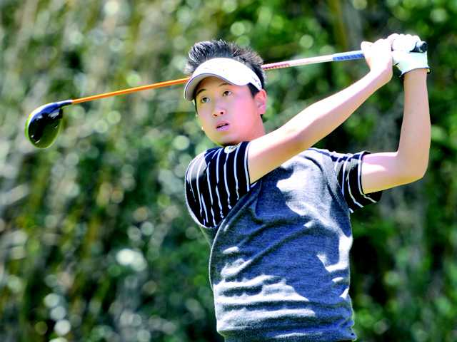 Golden Valley's Jonathan Kang watches his his drive off the first tee at Valencia Country Club on Tuesday.