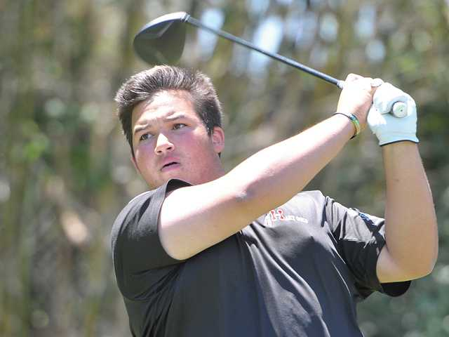 Hart High's Lorenzo Torres hits off the first tee at Valencia Country Club on Tuesday