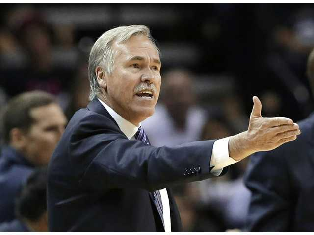 Mike D'Antoni resigned as the Lakers head coach on Wednesday after two seasons with the team. He went 67-87 after taking over early in the 2012-13 season.