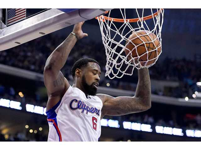 Clippers center DeAndre Jordan dunks against the Golden State Warriors during the first half in Game 5 of Tuesday's game in Los Angeles .