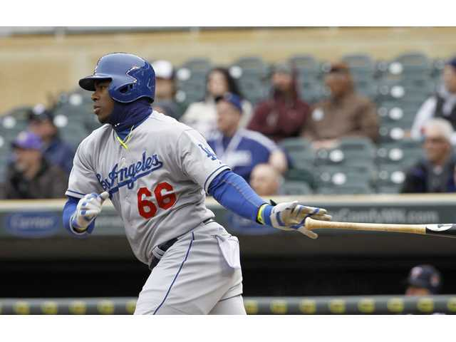 Los Angeles Dodger Yasiel Puig watches his single against the Minnesota Twins on Thursday in Minneapolis.