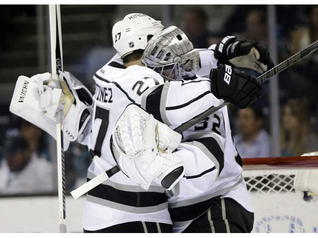 Los Angeles Kings goalie Jonathan Quick, right, celebrates a 5-1 win over the San Jose Sharks with teammate Alec Martinez (27) after Wednesday's Game 7 in San Jose.