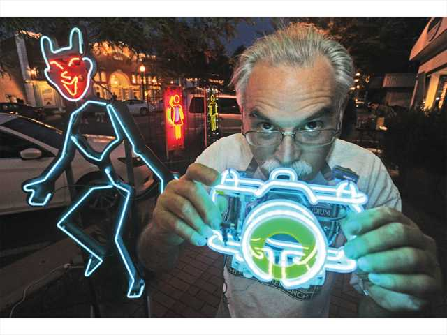 "Neon artist Michael Flechtner displays his original creations as part of the city of Santa Clarita's Art Slam event, with the theme ""Art of the Human Form,"" celebrating the beauty of the human figure. Signal photo by Dan Watson."