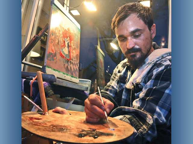Local artist Jesse Madden works on an oil painting on Main Street in Newhall during the third Art Slam of the series. Signal photo by Dan Watson.