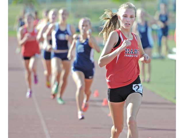 Hart's Bailey Pate leads the pack at the finish line to win the 800 meter at Saugus High School on Thursday.