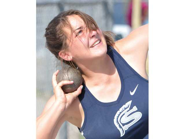 Saugus' Katie O'Brien competes against Hart in the shot put at Saugus High School on Thursday.
