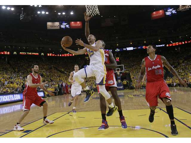 Warriors guard Stephen Curry (30) shoots against the Los Angeles Clippers during the first half of Thursday's Game 6 in Oakland.