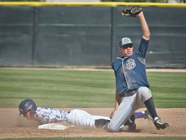 Saugus' Brendan Griffith tags out Valencia's Hunter Holland on Friday at Valencia High.