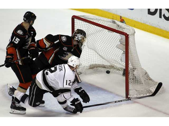 Kings right wing Marian Gaborik (12) scores on Anaheim goalie Jonas Hiller (1) and center Ryan Getzlaf (15) during overtime to win 3-2 in Game 1 of Thursday's second-round Stanley Cup playoff series in Anaheim.