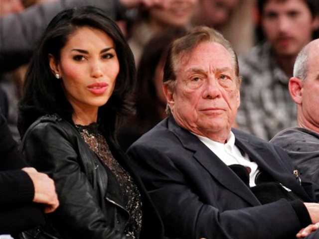 In this Dec. 19, 2010, file photo, Los Angeles Clippers owner Donald Sterling, third right, sits with V. Stiviano, left, as they watch the Clippers play the Los Angeles Lakers during an NBA preseason basketball game in Los Angeles.