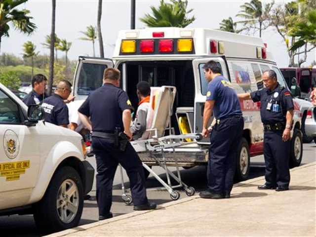 A 15-year-old boy, seen sitting on a stretcher center, who stowed away in the wheel well of a flight from San Jose, Calif., to Maui is loaded into an ambulance at Kahului Airport in Kahului, Maui, Hawaii Sunday afternoon, April 20, 2014.