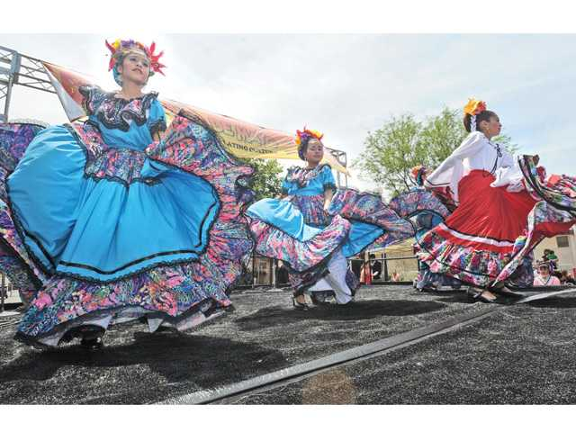 "The Folklorico dancers perform on stage for hundreds of attendees at the annual Cinco de Mayo event, ""A Celebration of Latino Culture,"" presented by the Latino Chamber of Commerce on in Old Town Newhall on Saturday."