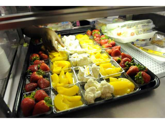In this Tuesday, April 29 photo, fruit and vegetables are served during lunch at the Patrick Henry Elementary School in Alexandria, Va.