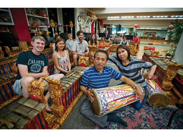 Nyoman and Nanik Wenten sit for a portrait with the Gamelan class they teach together at CalArts.