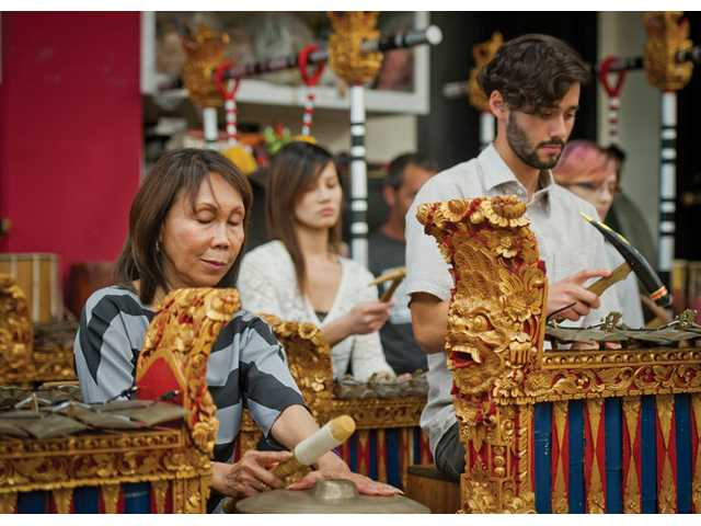 Nanik Wenten gongs with her gamelan students at CalArts. Gamelan is a type of traditional Indonesian music played with bronze percussion instruments.
