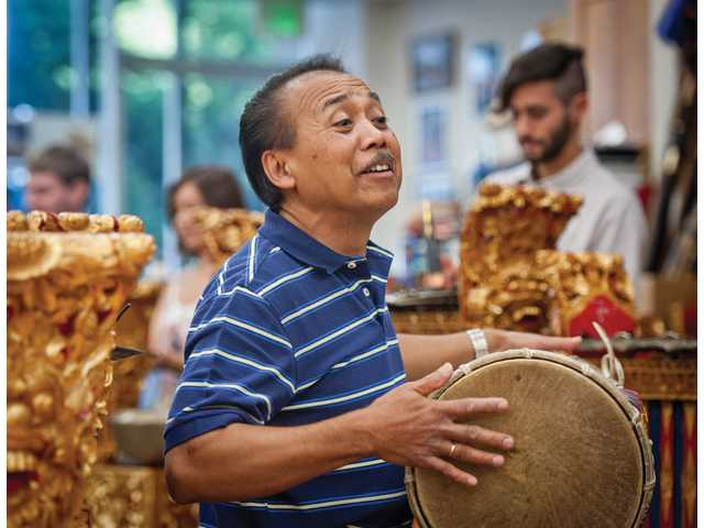 Nyoman Wenten plays a drum with his students in the Gamelan class he and his wife teach at CalArts.